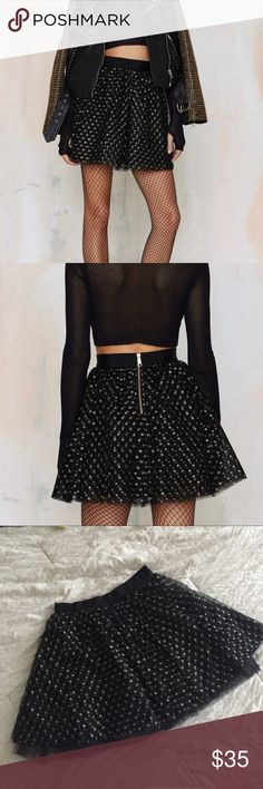 "Wanna Have Fun polka dot tulle skirt / NASTY GAL NWOT Black tulle skirt with gold, sparkly polka dots. Gold zipper up back. Lined on the inside. Length is approximately 16.5"" Nasty Gal Skirts A-Line or Full"