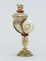 A GERMAN SILVER-GILT AND CORAL-MOUNTED TURBO SHELL CUP AND COVER MARK OF HANS BERTHOLD, NUREMBERG, CIRCA 1610, WITH 19TH CENTURY ALTERATIONS...
