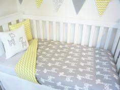 Yellow and grey giraffe nursery items by MamaAndCub on Etsy
