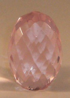 Faceted pink egg paperweight