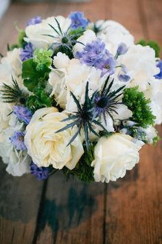 love this bouquet with blue thistle.  perfect for winter weddings!   Photography By / Jess Barfield   Floral Design By / Scarlet Petal