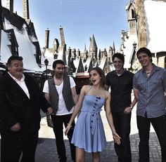 Emma Watson with Robbie Coltrane (Rubeus Hagrid), Matthew Lewis (Neville Longbottom, James and Oliver Phelps (Fred and George Weasley) at 'The Wizarding World of Harry Potter'.