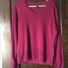 Maroon V Neck Sweater w Button Detail on Sleeves Maroon v neck sweater with button details on the bottom of the sleeves. Tiny hole near neck. Comes from smoke free house with a cat. Victor Sweaters V-Necks