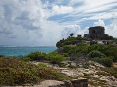 Tulum is a well-preserved Mayan site. It is located in the Yucatán Peninsula along the Caribbean Sea in the state of Quintana Roo. There are many structures to explore, including the central large pyramid, El Castillo, the Temple of the Frescoes, and the Temple of the Descending God.