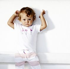Girls' shirt Evy by Noppies. Made of 95% cotton and 5% elastane. The short-sleeved shirt is lightly patterned and has a flamingo print. The button on the back makes it easy to put on and take off this shirt.: #noppies #babyfashion #girls #coolgirls #polkadots #ss15 #summer #spring #cutebaby www.noppies.com