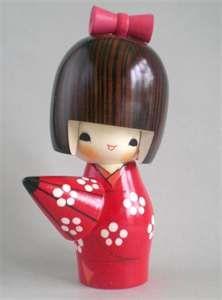 kokeshi with umbrella