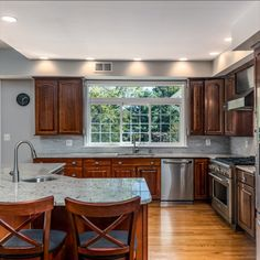Chef's kitchen with granite counter tops, center island, professional 6 burner gas range, tile backsplash and breakfast room. Listed for $1,250,000 in Vienna, VA by The Casey Samson Team, a Wall Street Journal Top Team in Northern Virginia.