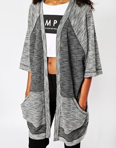 Enlarge Monki Kimono Cardigan $48.37 Made from a textured knit Open front Contrast panels Twin pouch pockets Kimono sleeves Regular fit  Bodysuit: 50% Cotton, 50% Polyester
