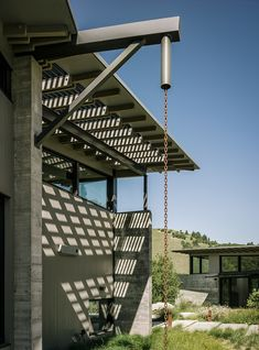 Butterfly House, designed by Feldman Architecture for David and Suzanne Rinaldo in California's Monterey County, is made up of three discrete structures separated by walkways. The distinct folds in the roofs are utilized for rainwater catchment.