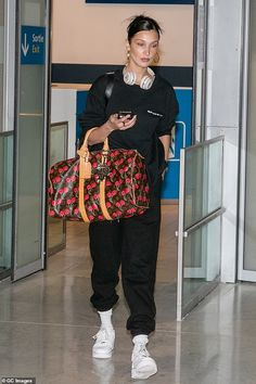 5b50898d0808 Bella Hadid arrives in Paris clutching a $12,000 Louis Vuitton holdall