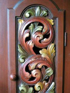 Carved door to clock case