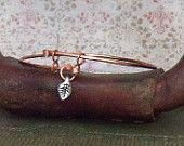 copper bangle with leaf drop bead