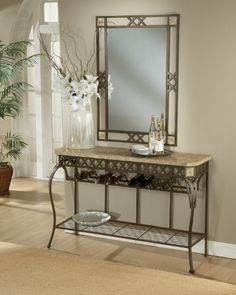 Something like this to put on the dining wall (not wood).  Server/Console Wrought Iron Table w Fossil Stone Top - Brookside Hillsdale Furniture http://smile.amazon.com/dp/B00B362AQW/ref=cm_sw_r_pi_dp_QJCAwb1F8EB6X