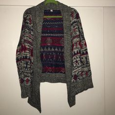 Billabong Navajo Printed sweater Pretty printed sweater by Billabong. (Tag was cut off because it was itchy.) size medium. Draped fit. Washed once and hung dry. Unfortunately this caused minor pilling. Still has lots of life left though! Price of reflection of minor pilling! one of my faves as I am a sucker for anything Navajo inspired. Billabong Sweaters Cardigans