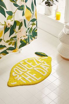 A constant reminder that when life hands you lemons, you should seize the day, thanks to this punny, lemon-shaped bath mat. Made from a fluffy terry loop with contrasting accents. **Content + Care** - cotton - Spot clean **Size** - Dimensions: x