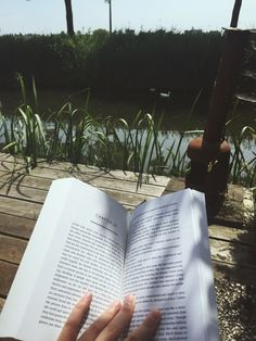 """romireads: """" Spot mr./mrs. Duck! . I found a new reading spot in my garden and it has the best view and it's kind of hidden, so I won't get any nosy people biking by, trying to talk to me..."""