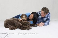 dog and owner photography of couple with their 1 year old brown australian labradoodle playing on ground
