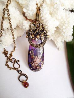 Beautiful purple sea sediment jasper pendant by jewelryshore