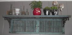 Shelves made from 2 old shutters and brackets....very charming!