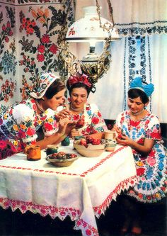Kalocsa women decorating eggs.  (We totally dress like this at my annual egg decorating party.)