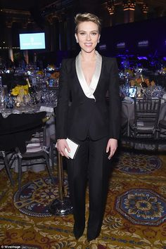 Scarlett Johansson flashes cleavage in plunging pantsuit at amFAR #dailymail