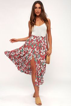 The O'Neill Kalani Rusty Rose Floral Print Maxi Skirt is a Boho chic look you will want to rock all summer long! Cute floral fabric shapes a high, elastic, waistband has an adjustable waist tie and cute ruffled trim. The breezy maxi skirt features high side slits. Free shipping and free returns!