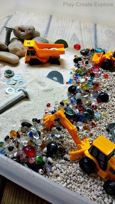 Play Create Explore: Construction Site Sensory Bin Gift Would love to make several play bins and store in garage, but worried about scorpions! Sensory Activities, Sensory Play, Preschool Activities, Sensory Boxes, Sensory Table, Construction Theme, Construction Machines, Small World Play, Toddler Fun