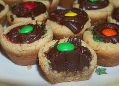 Mud Puddles A.K.A Fudge Puddles - Peanut Butter Cookie Cups that are filled with FUDGE!  Yummmmmm