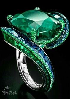 """High Jewellery Collection Ring by De Grisogono, Emeralds and Sapphires set in White Gold. """" High jewellery is the purest expression of de Grisogono style. A spectacular theatre of Contemporary Baroque. The art of an unorthodox Jewellery approach. Emerald Jewelry, High Jewelry, Luxury Jewelry, Jewelry Rings, Jewelry Accessories, Jewelry Design, Emerald Rings, Ruby Rings, Ear Rings"""