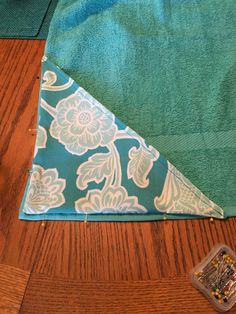 7. Pin and see the triangle to the bottom of the towel along the side and bottom edge.