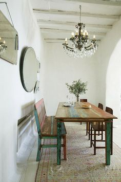 2 of my favorite things in one - a long wooden table and chandelier.