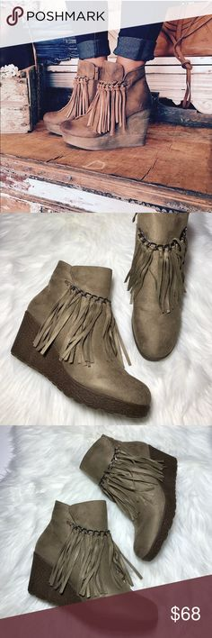 """Ankle Bootie Little Wedge With Fringe Details These adorable wedge ankle booties are the perfect complement to your wardrobe! The design features taupe suede uppers, rounded toes and a decorative chain with fringe that adorns the front of the boot. The stylish wedge heel measures 3""""; platform measures .75"""". Lightly cushioned insole for added comfort. Side zipper closure for easy on and off. Boutique Shoes Ankle Boots & Booties"""