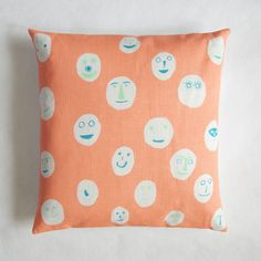 Image of Masks cushion - neon coral by Hazel Stark