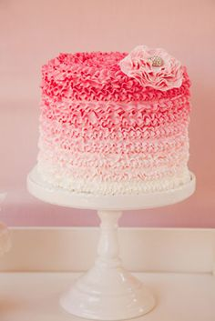 Pink ombre cake with a beautiful toy stallion on top??