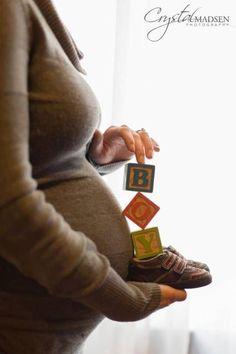 foto barriga grávida com roupa frio