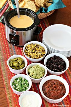 An easy menu for parties like Game Day and Cinco de Mayo that\'s always a crowd pleaser. Queso, chips and a variety of toppings are all you need. Make ahead convenience, too!  #Queso #Nachos #Dip #CheeseSauce #SlowCooker #CrockPot #MakeAhead #QuesoDip #GameDay #CincoDeMayo #Buffet #Party