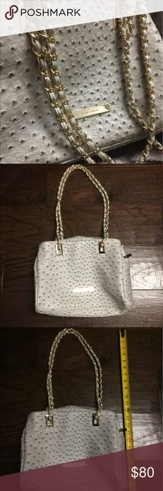 Ivanka Trump Gray Ostrich purse Ivanka Trump Ostrich gray purse. Beautiful gold hardware along both shoulder straps and small details inside & outside the purse. Used a hand full of times. Like new. Ivanka Trump Bags Shoulder Bags