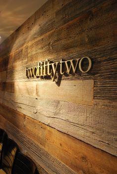 Watercut Lettering on Rustic Wood Background