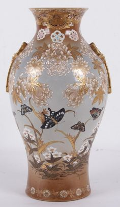"A Large Japanese Satsuma Vase  Early 20th century, baluster form with chrysanthemum and butterfly decoration and decorative gilt ring and tassel handles. About 11 1/2"" in diameter and 18 3/4"" tall."