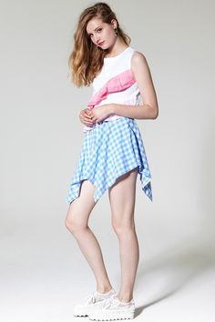 Kimmy's Gingham Skort Discover the latest fashion trends online at storets.com