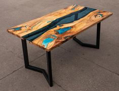 River glass live edge dining elm table with turquoise glowing image 0 Resin Table, Glass Dining Table, Wood Table, Articles En Bois, Steel Paint, Powder Paint, Tung Oil, Condo Decorating, Live Edge Table