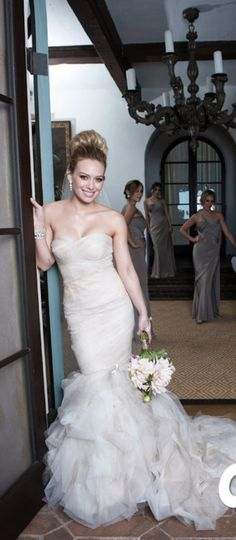 Hillary Duff wore a stunning custom Vera Wang mermaid gown for her wedding to Mike Comrie on August 14th, 2010 in Santa Barbara, California. Hillary's bridesmaids wore the Evelyn gown from Fall 2010 done in a smoky lavender color. Vera Wang gowns are sold at The Bridal Salon at Saks Jandel.