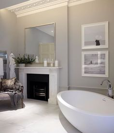 Lovely bathroom from one of our Belgravia projects. The grandeur of the space is softened with the addition of an armchair - perfect for relaxing #bathroom #interiorarchitecture #Belgravia #liveableluxury #helengreendesign #interiordesign #londoninteriors
