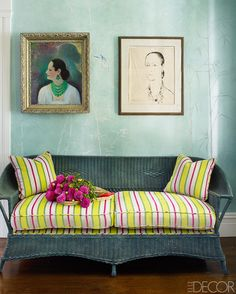 A vintage wicker sofa with cushions in a Manuel Canovas fabric in the front hall; a painting and drawing of Rubinstein, both by Toni Berli, hang against a wall mural by Robert Hoven.   - ELLEDecor.com