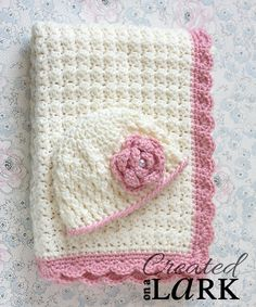 Beautiful ivory and pink crochet baby blanket and hat.