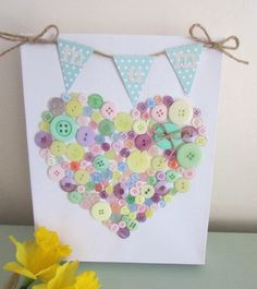 DIY Button Canvas | Creative DIY Mother's Day Gifts Ideas | Thoughtful Homemade Gifts for Mom. Handmade Ideas from Daughter, Son, Kids, Teens | Unique, Easy, Cheap Do It Yourself Crafts To Make for Mothers Day, complete with tutorials and instructions http://thrillbites.com/diy-mothers-day-gift-ideas