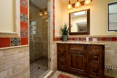 Pool and guest bath in 100-year old Spanish revival home.  http://www.jacksondesignandremodeling.com/traditional-bathrooms-san-diego/reawakened-beauty