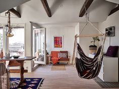 Scandi boho attic apartment with exposed beams