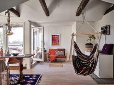 Scandi boho attic apartment with exposed beams