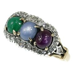 Estate diamond ring with cabochon star sapphire star ruby and cabochon emerald